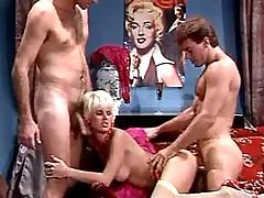 Two guys jizzing on breast of milf
