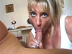 Busty mature slut gobbles hard cock