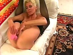 Mom in stockings plays with dildo