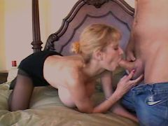 Busty milf sucks dick with pleasure