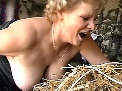 Mom with big tits has fun outdoor