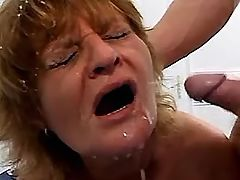 Redhaired mom has cumshot in orgy