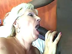 Lewd grandma throats huge black cock and fucks